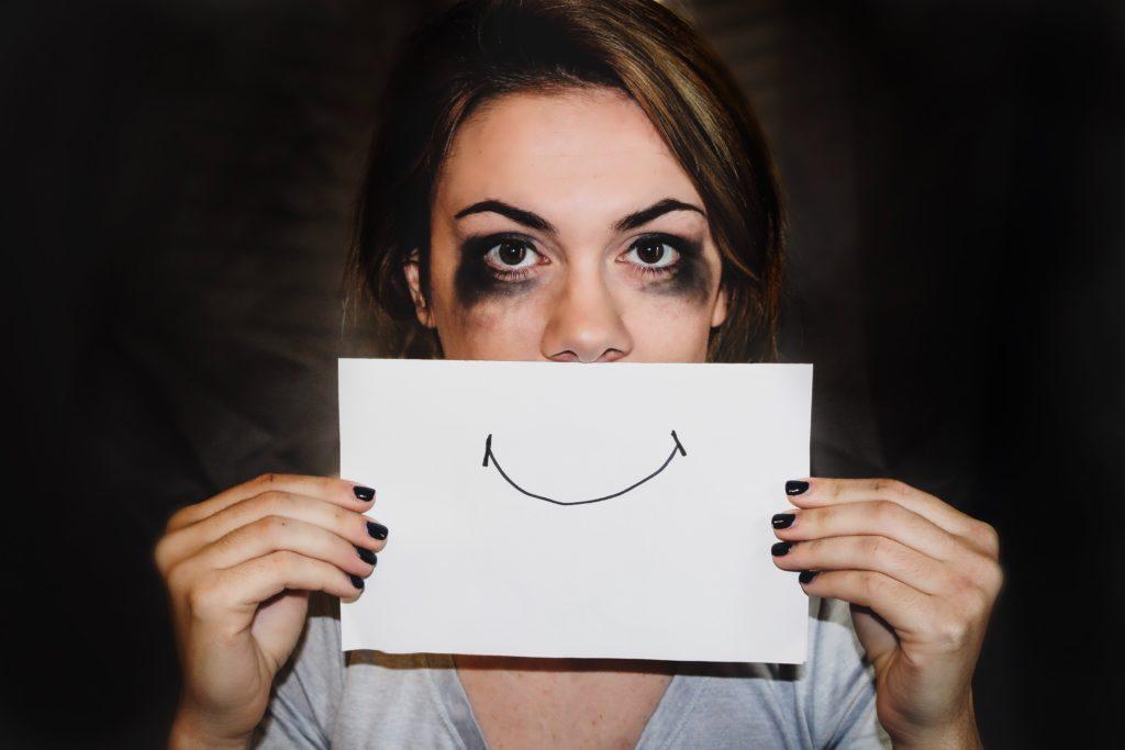 Sad woman trying to smile